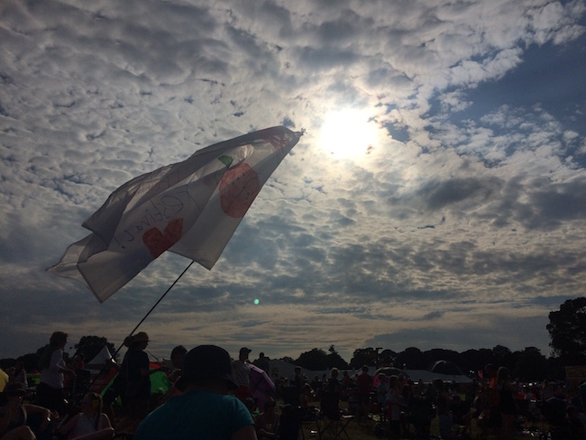 Musical crowds and festival flags at sunset